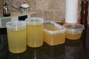 clean-strained-chicken-soup-broth-in-containers