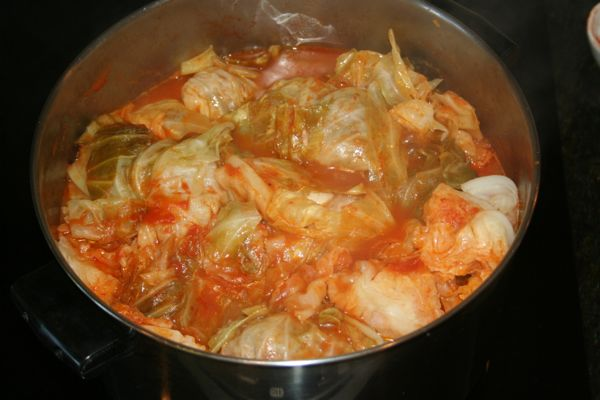 fresh stuffed cabbage rolls cooking in tomato sauce homemade