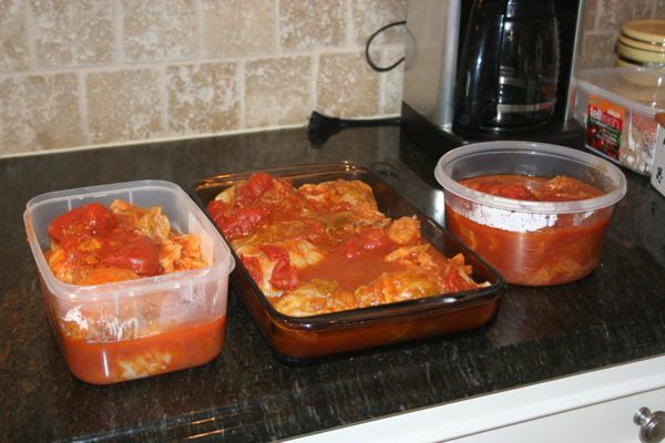 fresh homemade stuffed cabbage rolls ready for storage in the freezer