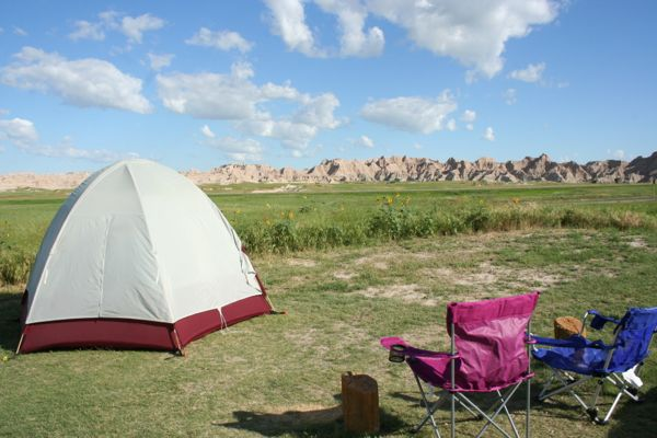 camping-chairs-and-tent-badlands-sunset